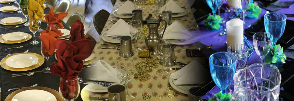 three differenttables with  elaborate place settings for formal dinner